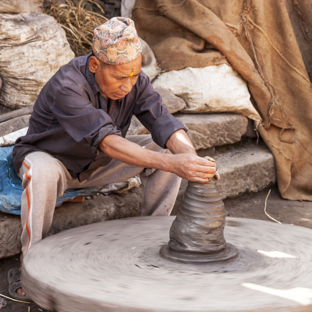 """Working the Potters Wheel"" stock image"