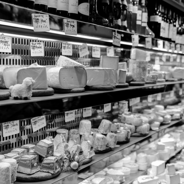 """""""French cheese shop in Paris with dozens of kinds of French chees"""" stock image"""