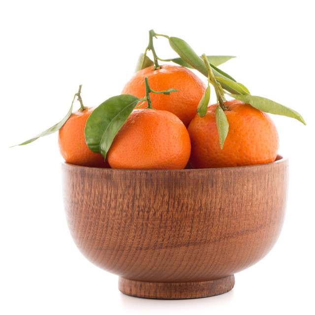 """Tangerines on wooden bowl"" stock image"