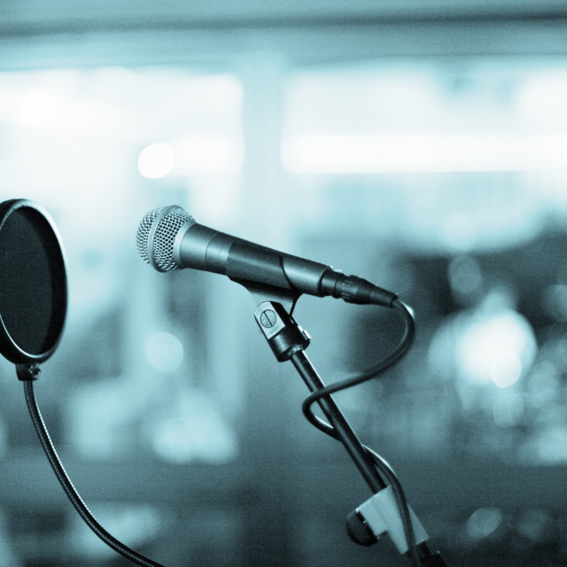 """Microphone and pop shield in recording studio"" stock image"