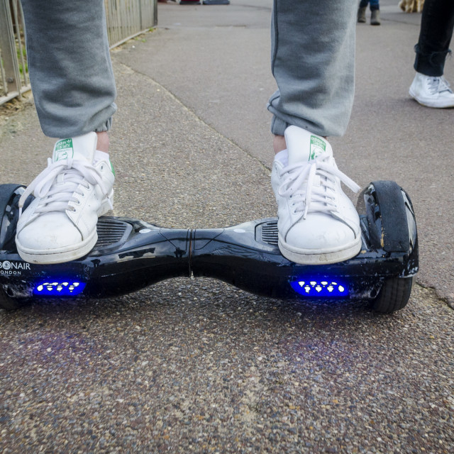 """""""Person Riding a HoverBoard on a Public Footpath"""" stock image"""