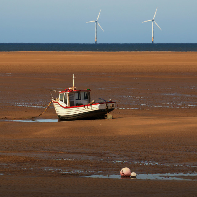 """Offshore Wind Turbines with fishing boat"" stock image"