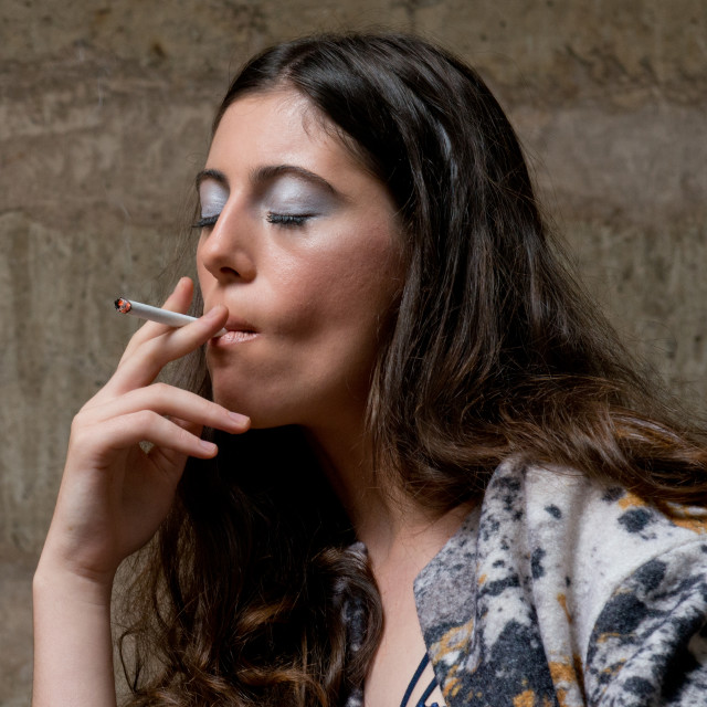 """young woman smokes cigarette with the closed eyes"" stock image"
