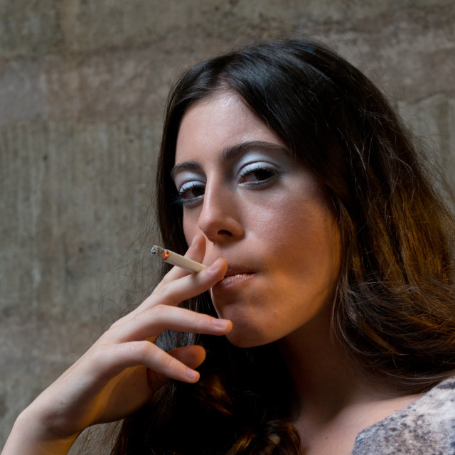 """young woman smokes cigarette"" stock image"