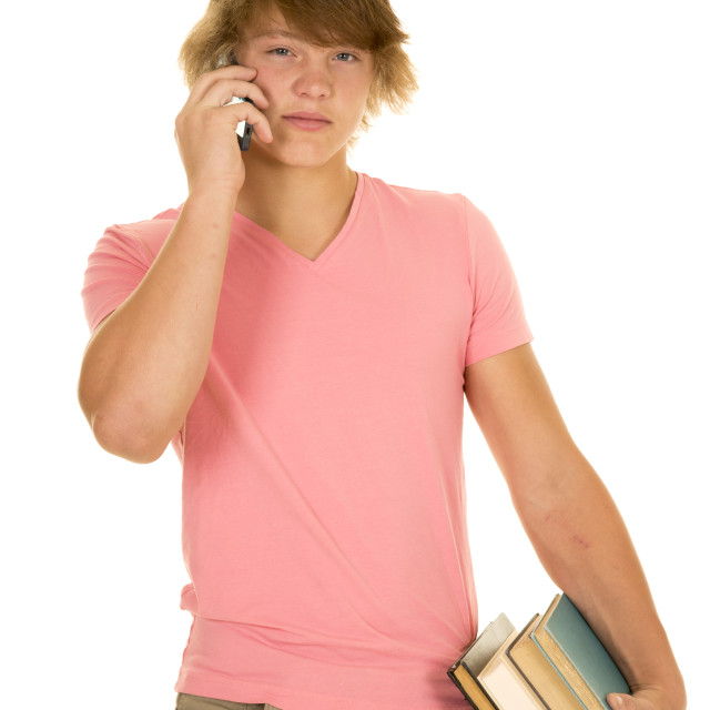 """young man in pink shirt talk on phone hold books"" stock image"