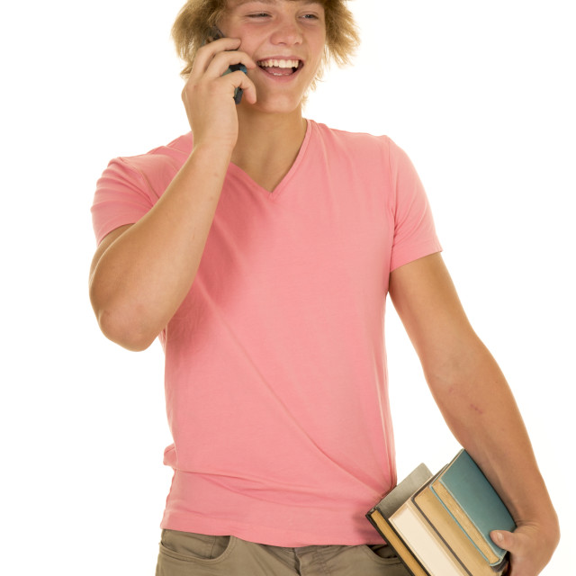 """young man in pink shirt talk on phone smile hold books"" stock image"