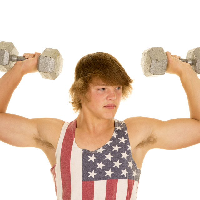 """young man in striped tank top weights flexed"" stock image"
