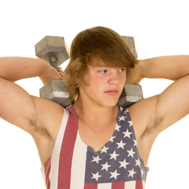 """young man in striped tank top weights on shoulders"" stock image"