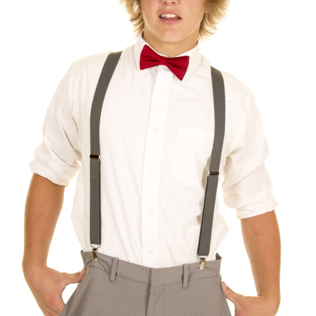 """young man in suspenders stand smile"" stock image"