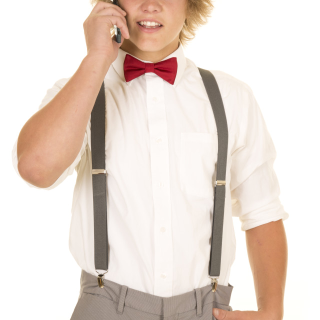 """young man in suspenders talking on the phone"" stock image"