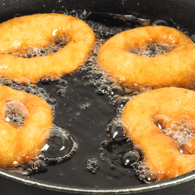 """Closeup of doughnuts boiling"" stock image"