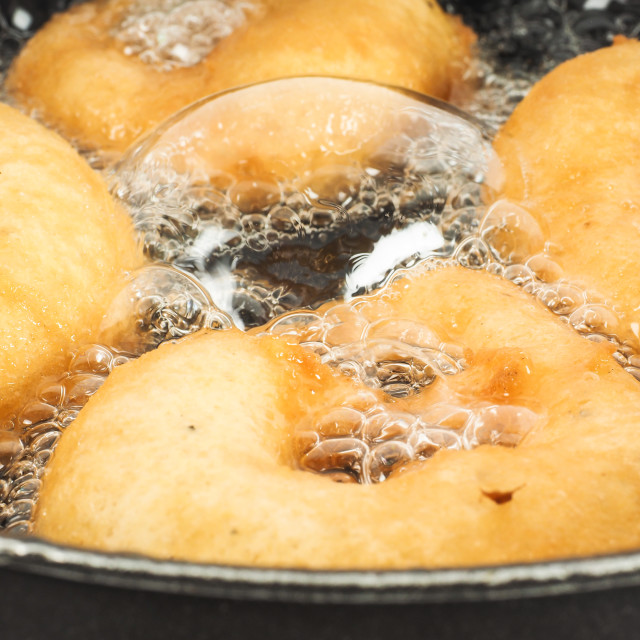 """Closeup of donuts cooking in boiling"" stock image"