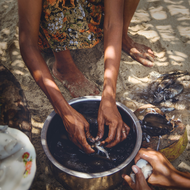 """A Myanmar Woman Preparing Squid"" stock image"