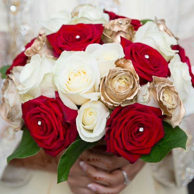 """red and white bouquet holding"" stock image"