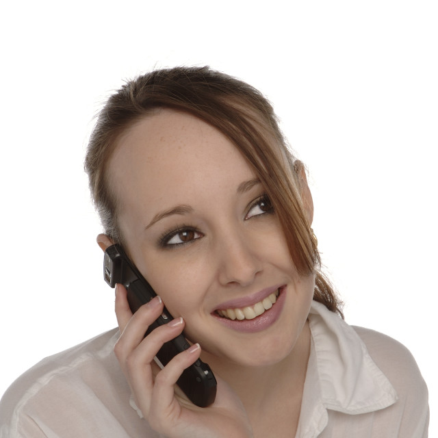 """Young Woman Using Mobile Cell Phone"" stock image"