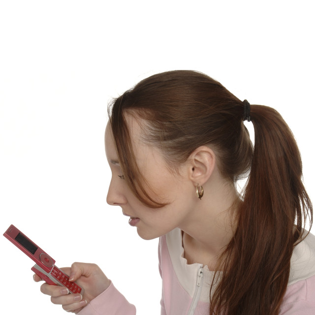 """Pony tail mobile user"" stock image"