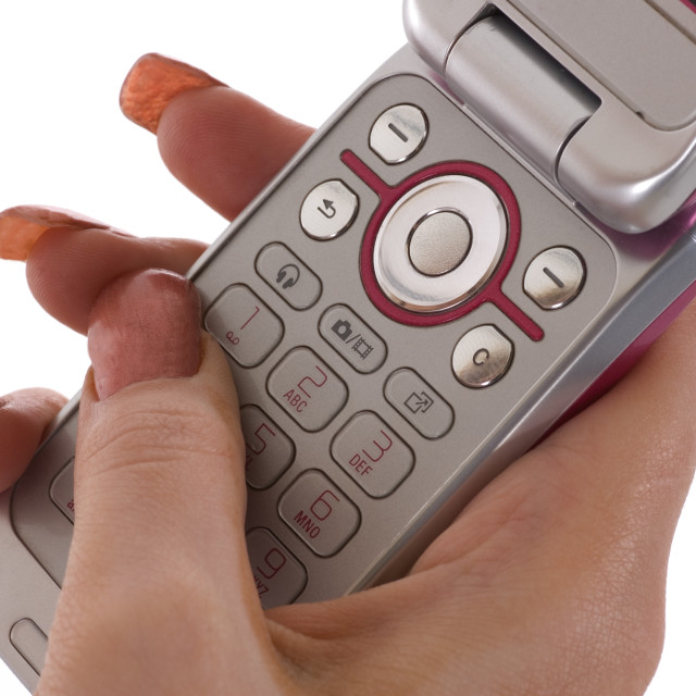 """Texting on Phone Keypad"" stock image"