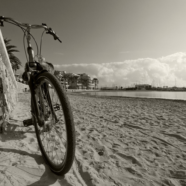 """Bike by sandy beach"" stock image"