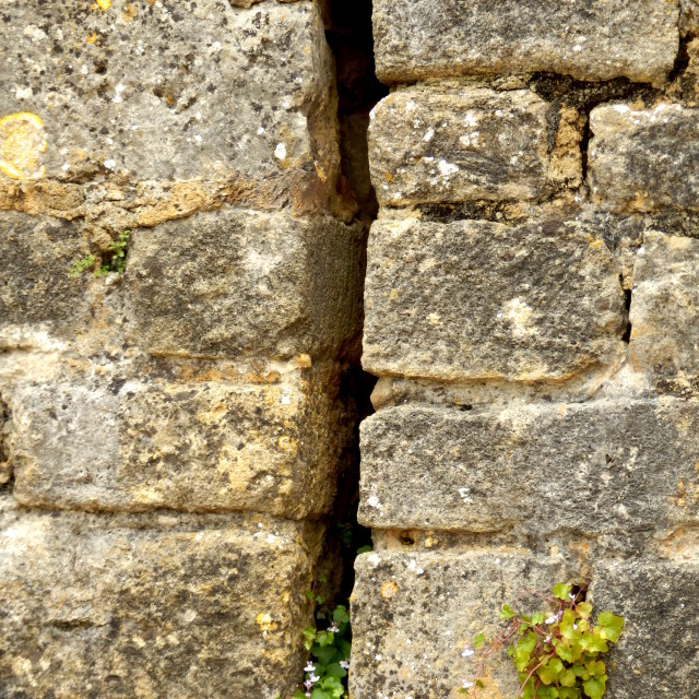 """Arrow slit in medieval wall"" stock image"