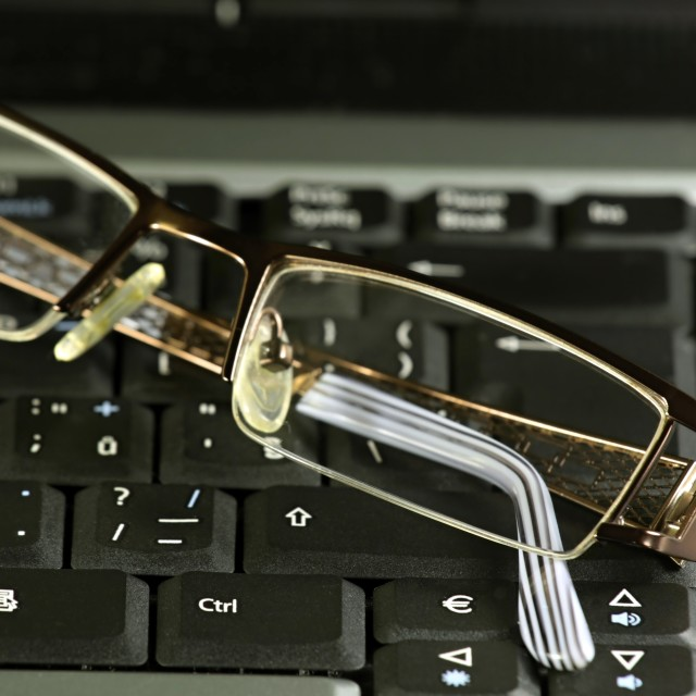 """Business glasses on a laptop keyboard"" stock image"