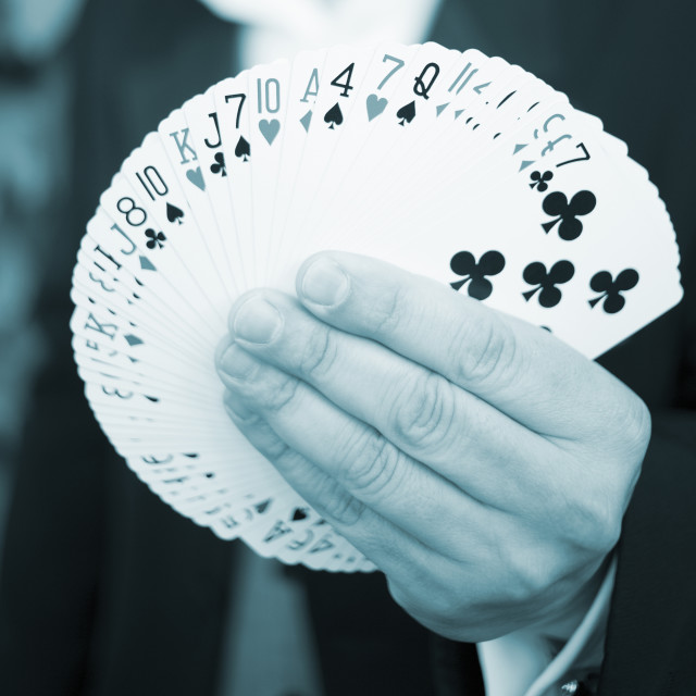 """Playing cards in hand of magician"" stock image"
