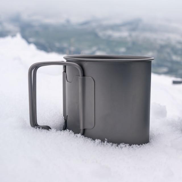 """""""Titanium Mug in the Snow"""" stock image"""