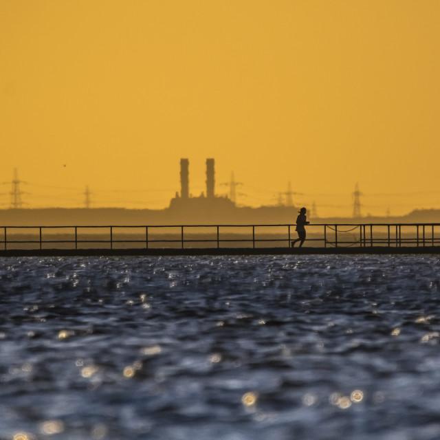 """Lonely lake runner"" stock image"