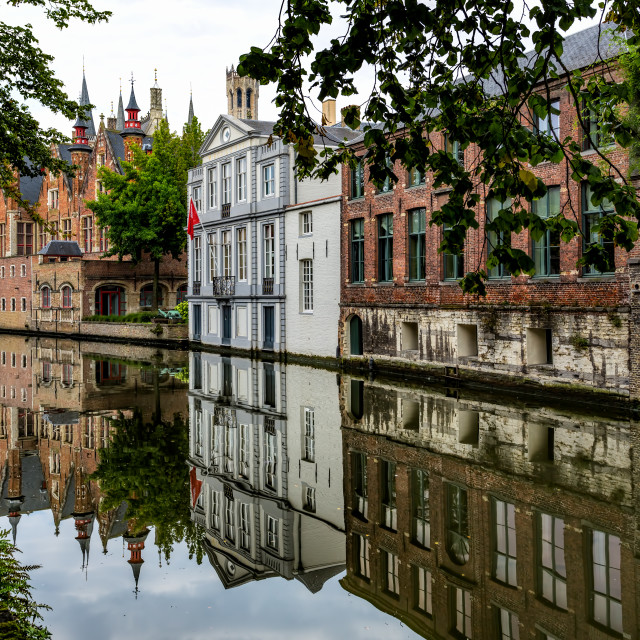 """Reflections in a Canal Bruges Belgium"" stock image"