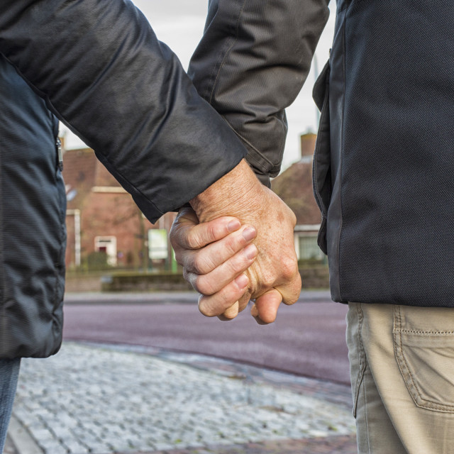 """""""Middle aged couple holding hands"""" stock image"""