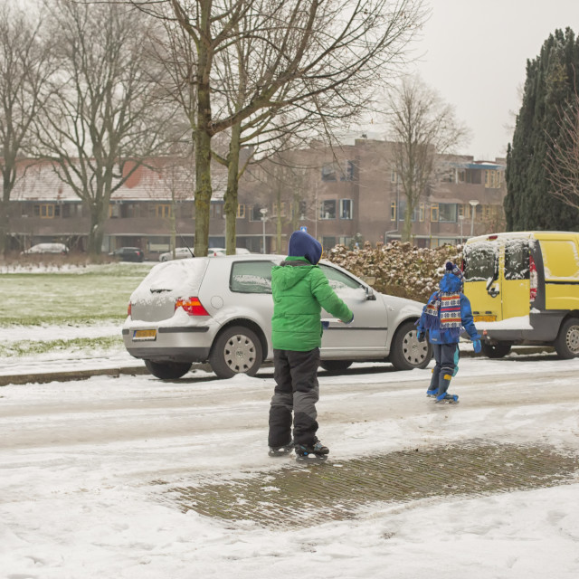 """Ice skating on a glazed road"" stock image"