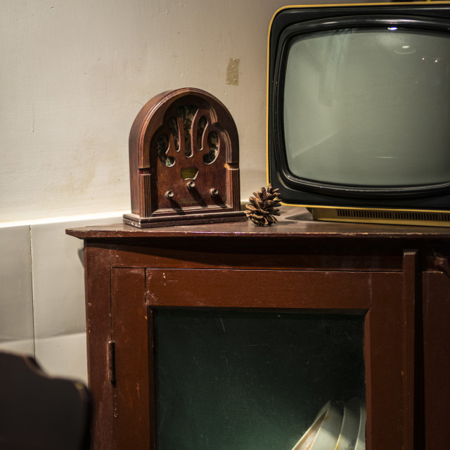 """An old TV and an old radio on a chinese style cabinet"" stock image"