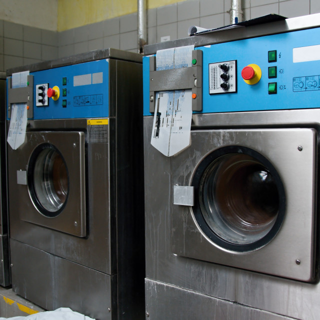 """""""A row of industrial washing machines"""" stock image"""