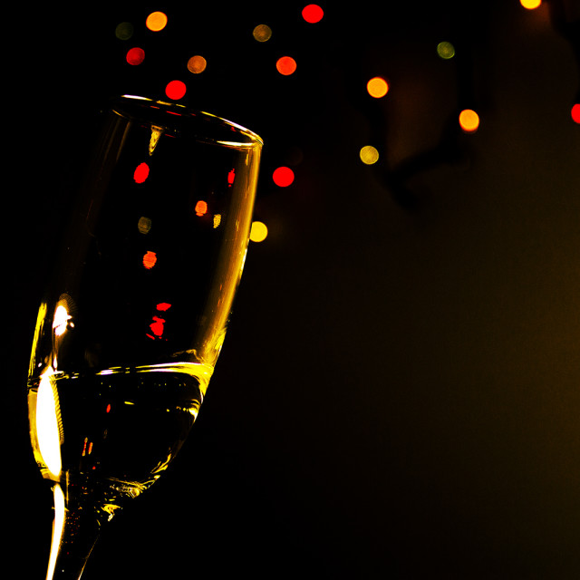"""""""Champagne glass with colored bubbles"""" stock image"""