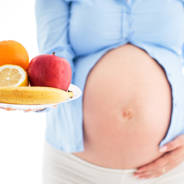 """""""Pregnancy and nutrition diet - pregnant woman with plate of frui"""" stock image"""