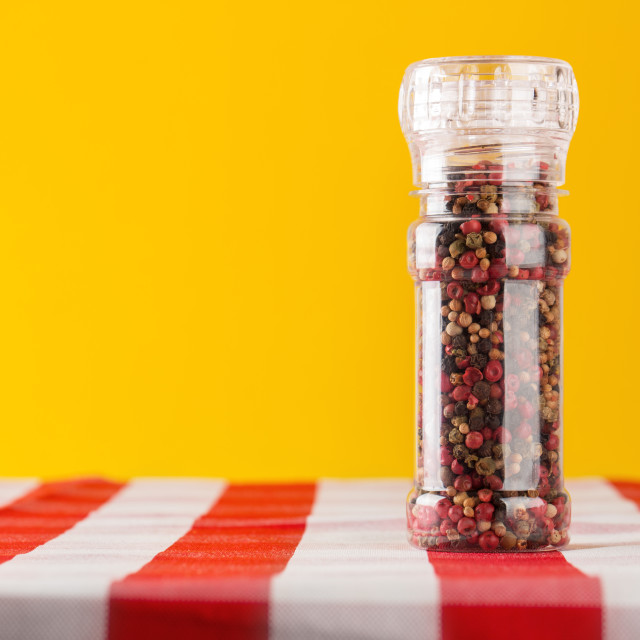 """""""Colored Peppers Mix and pepper mill on tablecloth"""" stock image"""