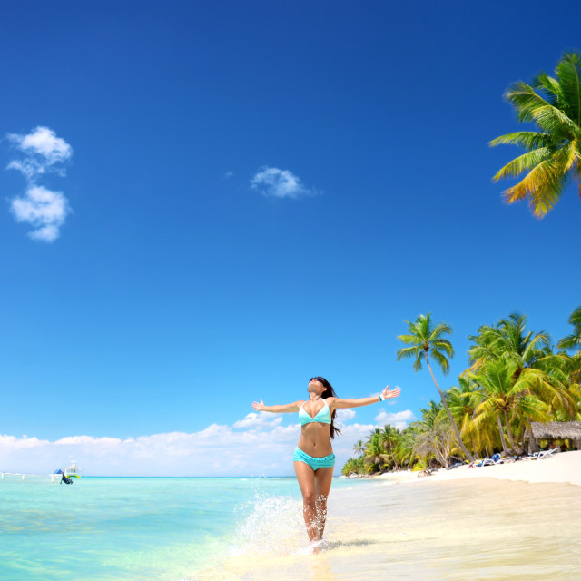 """""""Carefree young woman relaxing on tropical beach"""" stock image"""