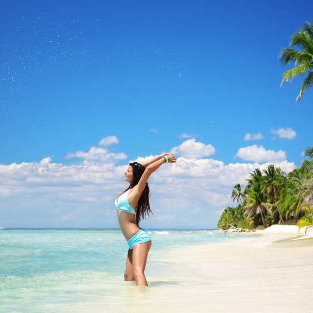 """""""Carefree young woman enjoying clear water of the carribean sea"""" stock image"""