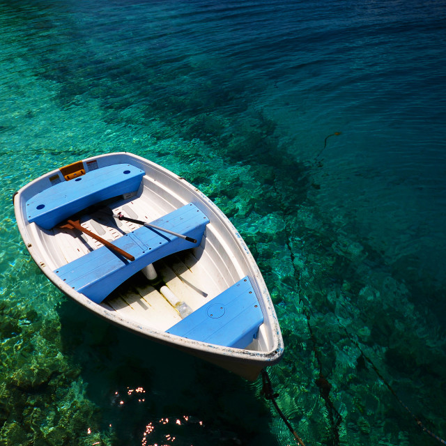 """Boat in blue water"" stock image"