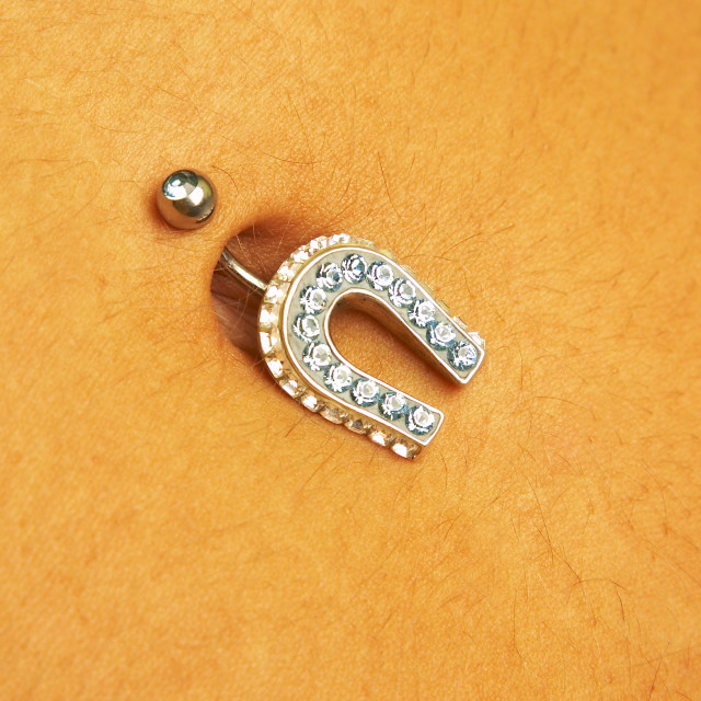"""female navel with piercing"" stock image"