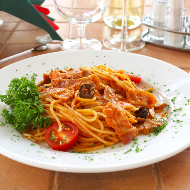 """Spaghetti with a tomato sauce on a table in cafe"" stock image"