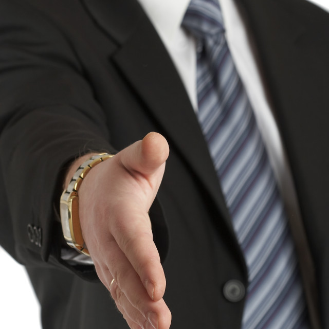 """""""The businessman concludes the transaction, stretches a hand."""" stock image"""