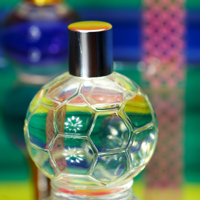 """Glass bottles with perfumery. On a color background with reflection..."" stock image"