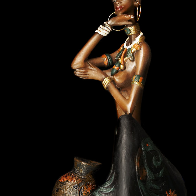"""Figurine of the African girl on a black background"" stock image"