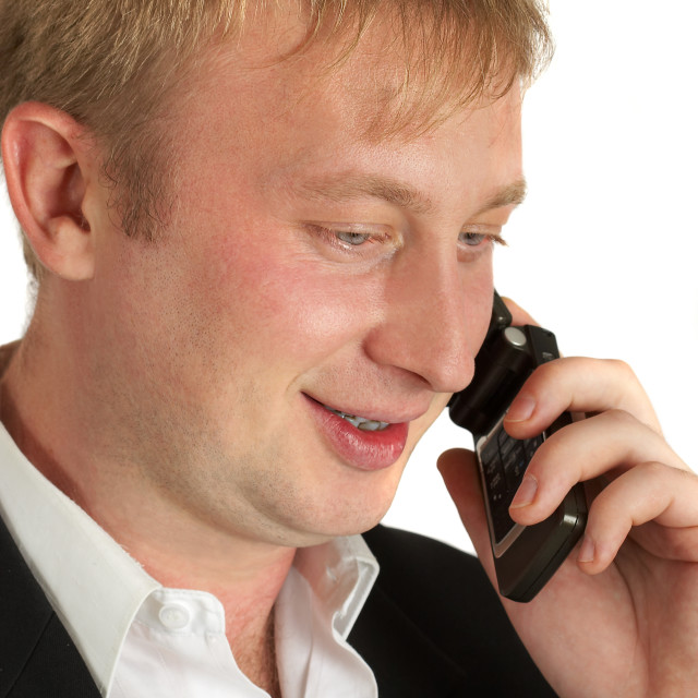 """The businessman speaks by phone. Conducts conversation."" stock image"