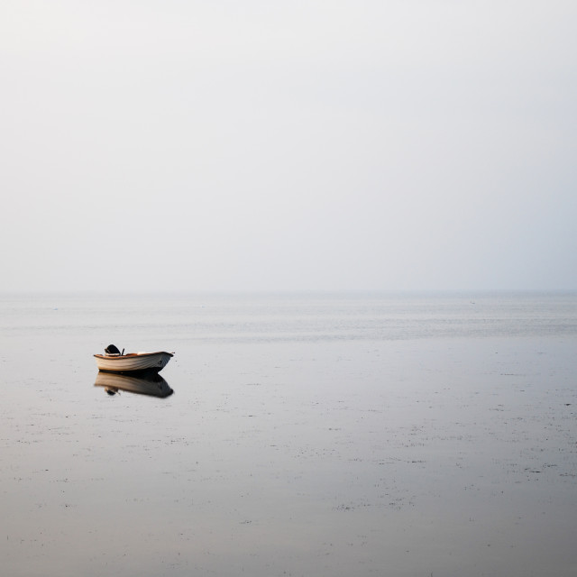 """Solitude rowing boat in the water"" stock image"