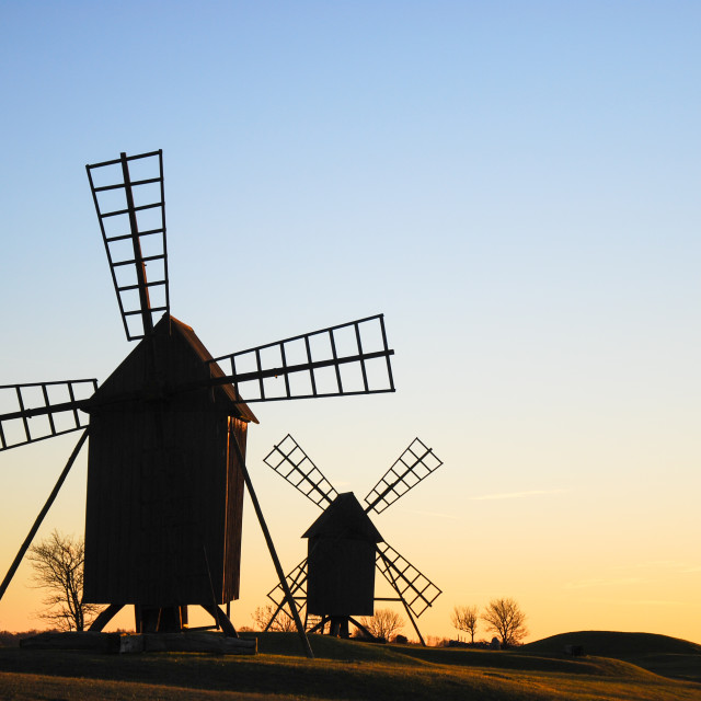"""Windmills silhouettes"" stock image"