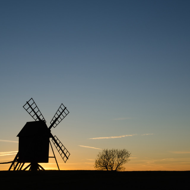 """""""Old windmill silhouette by sunset"""" stock image"""