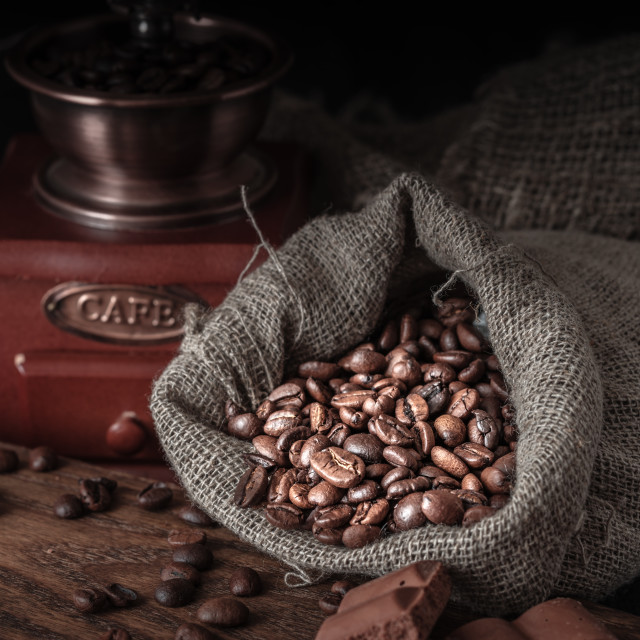 """""""Bag of coffee beans on a dark background."""" stock image"""