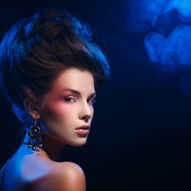 """""""Dramatic portrait of a beautiful girl with earrings"""" stock image"""