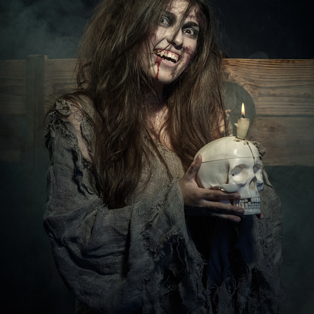 """""""Halloween. The vampire with a skull in hands"""" stock image"""